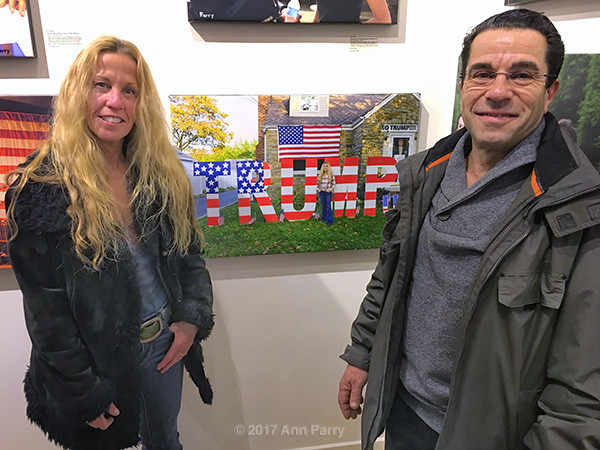 "Huntington, New York, USA. March 5, 2017. EILEEN FUSCALDO and husband BILL pose next to 2016 photo of Eileen, at Opening Reception for ""Her Story Through Art"" Invitational Art Show, celebrating Women's History Month, at Huntington Arts Council."