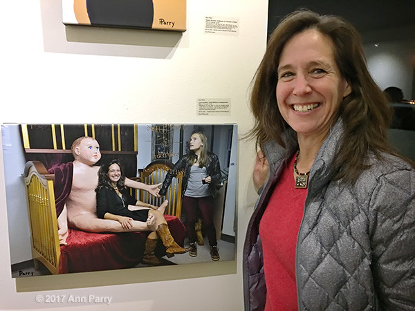 "Huntington, New York, USA. March 5, 2017. LORI HOROWITZ next to 2014 photo of herself by Ann Parry, at Opening Reception for ""Her Story Through Art"" Invitational Art Show, celebrating Women's History Month, at Huntington Arts Council, Main Street Gallery."