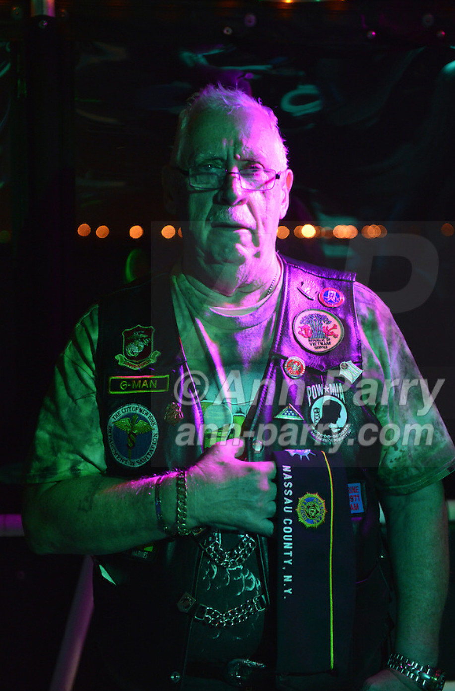 Freeport, NY, USA. 10th Sept. 2014. FRANK NEAL, of Hempstead, an American Legion Riders Post #1488 member, holds his hand over his heart while 'Gold Bless America' is sung, at night on board the boat Miss Freeport V, which sailed from the Woodcleft Canal of Freeport Nautical Mile after a dockside remembrance ceremony in honor of victims of the terrorist attacks of September 11 2001.
