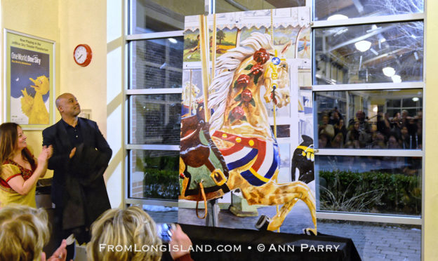 Garden City, New York, USA. March 9, 2019. Unveiling ceremony of mural by painter Michael White, of close-up of a Nunley's Carousel horse, is held at historic Nunley's Carousel in its Pavilion on Museum Row on Long Island. © 2019 Ann Parry, AnnParry.com