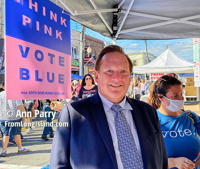 Bellmore, New York, U.S. September 25, 2021. At center, JASON ABELOVE, the Democratic candidate for Town of Hempstead Supervisor, visits the South Shore Women's Caucus booth at the 34th Annual Bellmore Family Street Festival.